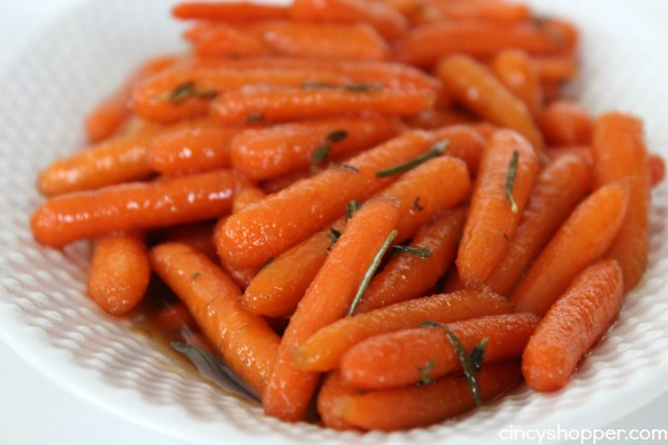 Honey Glazed Carrots Perfect for a Thanksgiving, Christmas or any day side dish. Lots of great flavors of honey, brown sugar, butter, and thyme!
