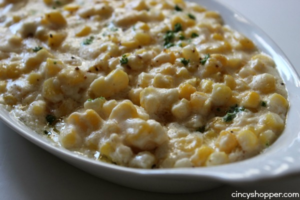 Slow Cooker Creamed Corn Recipe- This corn is loaded with creamy flavors and requires just a few ingredients!
