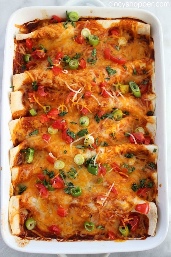 Easy Beef Enchiladas- Enjoy a Mexican Dinner at home in no time at all. Full of great flavor and smothered with cheese