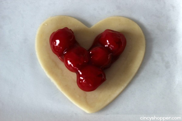 Easy Valentine Heart Pies- Simply made with a store bought pie crust and cherry pie filling. How simple is that?