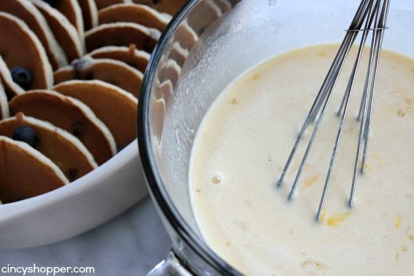 Blueberry Pancake French Toast Casserole- Blueberry Pancakes meet French Toast in this awesome breakfast dish!