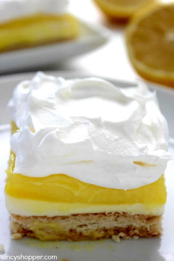 Lemon Lush Bars- Delicious Layered dessert. Super simple and tastes AMAZING! Great summer dessert.
