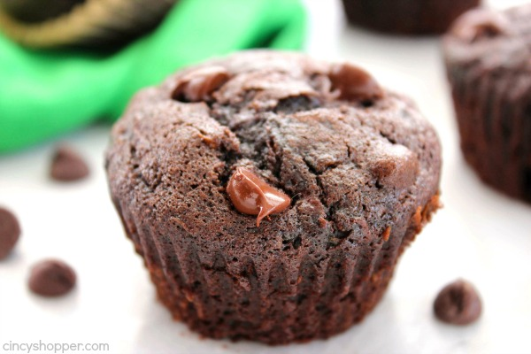 Double Chocolate Zucchini Muffins - Super Moist. Loaded with double the chocolate and perfect for using up your left over garden zucchini.