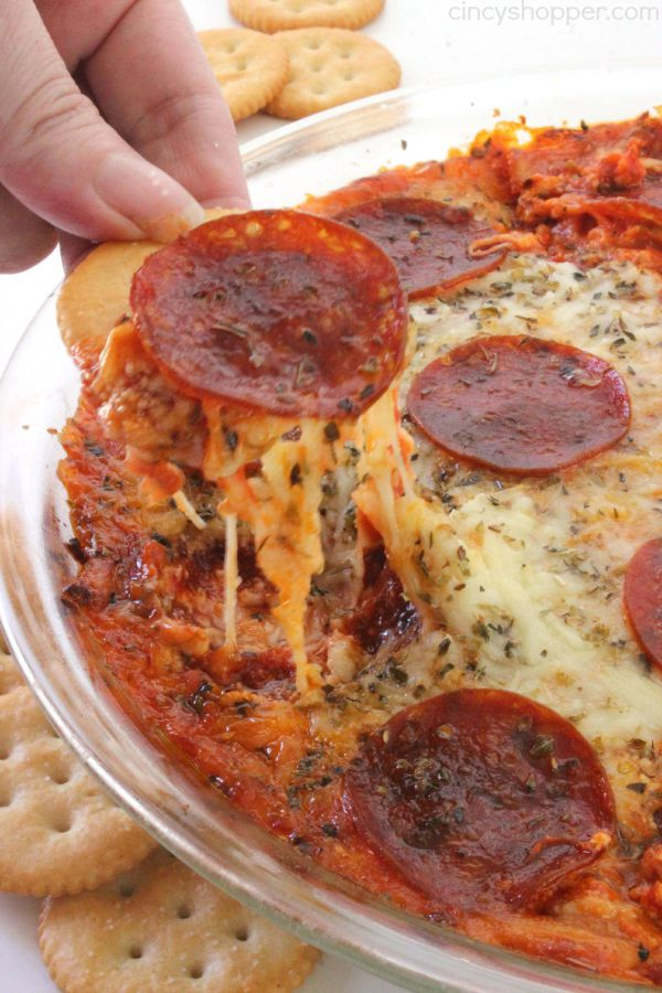Easy Cheesy Pizza Dip - simple hot dip that is perfect appetizer for serving a crowd. You will find a cream cheese layer with Italian Spices, a layer of pizza sauce, pepperoni, and lots of cheese