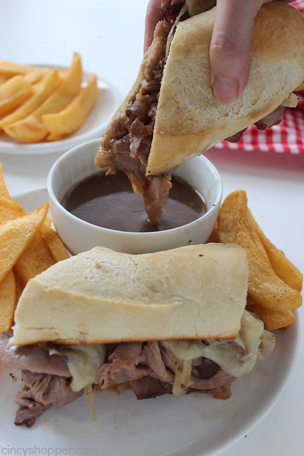 These Easy Crock Pot French Dip Sandwiches are as simple as adding the ingredients to your slow cooker and letting it infuse your house with the intoxicating aroma of beef simmering in a richly seasoned au jus until it reaches mouthwatering perfection.