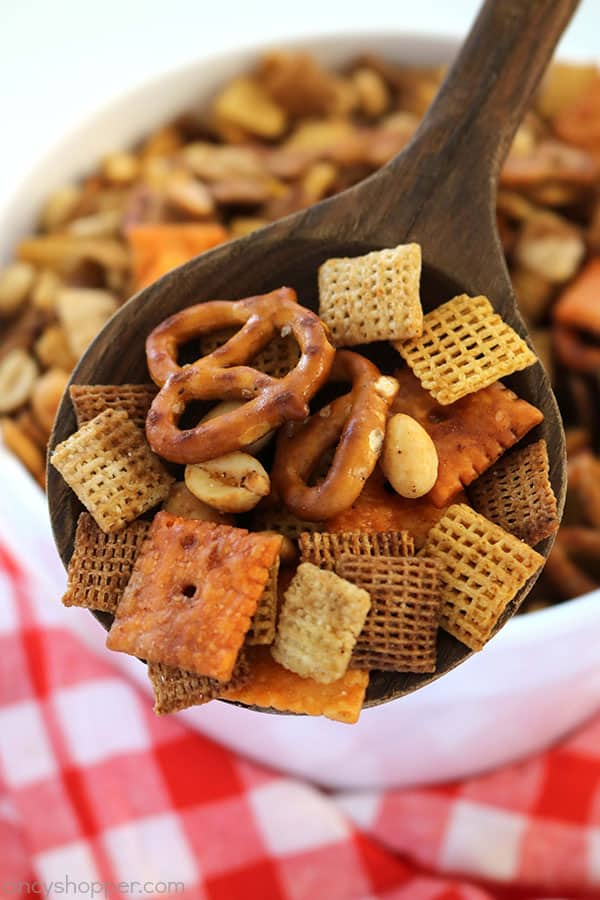 This Slow Cooker Party Mix will perfect for every day snacking, holiday parties, movie nights, and great for Game Day. This stuff feeds a crowd. So simple to make since it is made right in your Crock-Pot.
