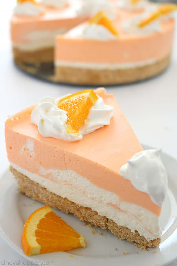 If you are a fan of Creamsicles, you are going to want to make this No Bake Orange Creamsicle Cheesecake this summer. You will find a delicious Nilla Cookie crust with layers of orange creamy cheesecake filling. Perfect for summer picnics and BBQ's. #Cheesecake #Creamsicle #Orangedessert