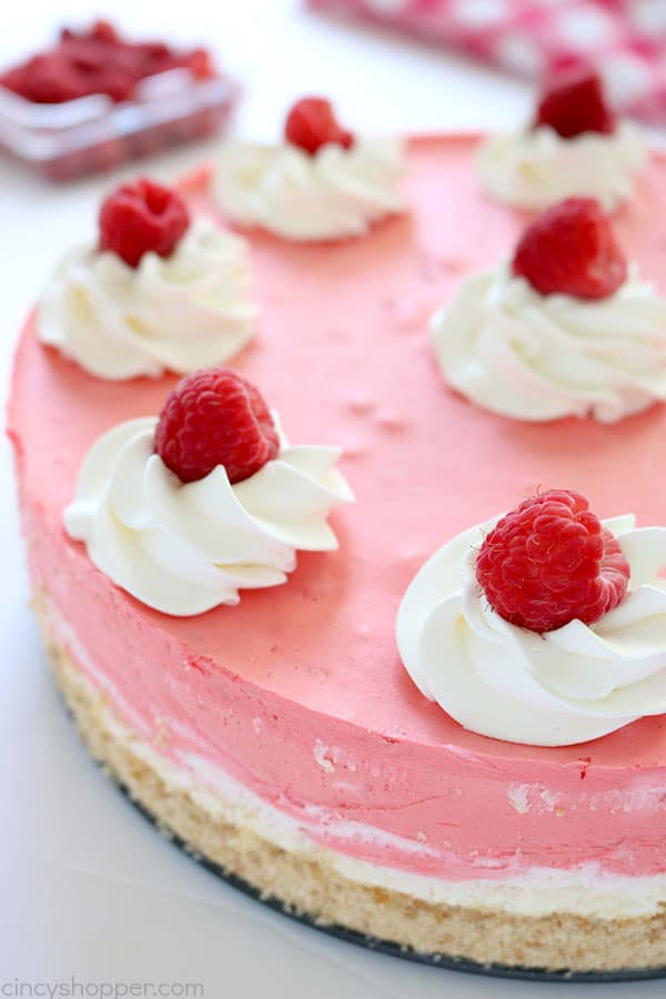 This No Bake Raspberry Creamsicle Cheesecake is out of this world AMAZING! We start with a Nilla Wafer crust, then add on layers of delicious raspberry cream. It's so simple to make. perfect summer dessert. #Cheesecake #NoBake