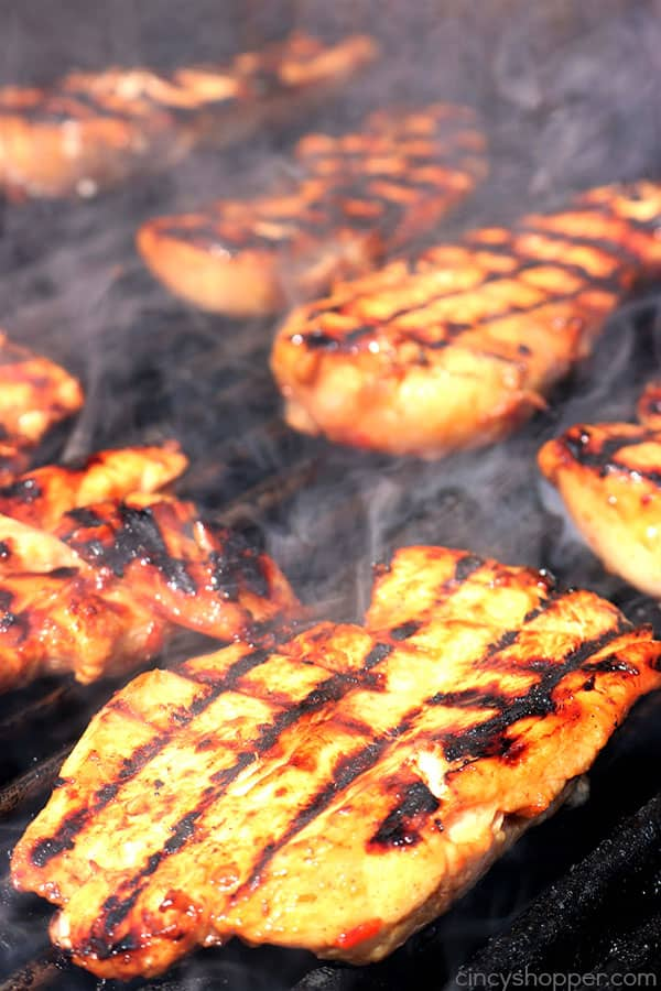 If you are looking for a delicious chicken to make on the grill this summer, this Sweet Chili Grilled Chicken is a must try. You will find the flavor a little sweet, a little spicy... a bit of an Asian flare. #grilledchicken