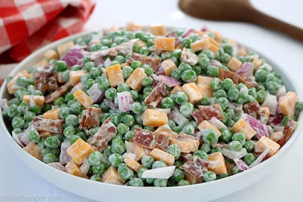 Creamy Pea Salad - a fantastic side dish for summer meals and BBQ's. It's not your basic pasta or potato salad that can sometimes get boring. Even the non-pea loving fans will love it! #SummerSalad #PeaSalad #SideDish