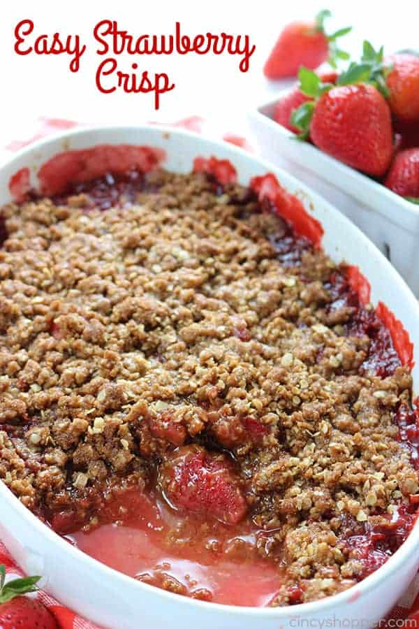 Easy Strawberry Crisp - simple and comforting strawberry dessert. Serve it with or without a scoop of vanilla ice cream. Perfect combination of  warm strawberries and crunchy oat topping. Super delicious! #StrawberryDessert