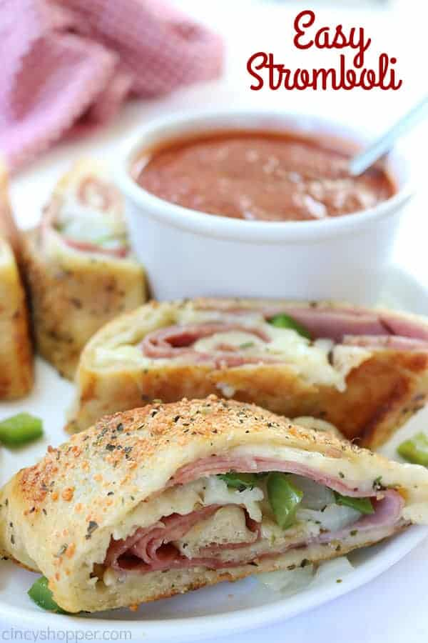 Easy Stromboli - Since we use store bought pizza dough, it comes together in no time at all. Load in your favorite toppings like ham, salami, provolone, mozzarella, peppers, onions, the combinations are endless.