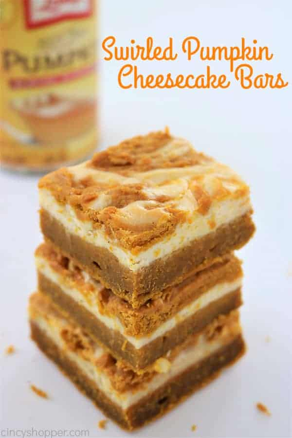 Swirled Pumpkin Cheesecake Bars - better than a pumpkin pie! Tasty pumpkin bar with a delicious swirled layer of cream cheese. Perfect fall and Thanksgiving dessert.