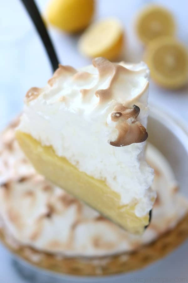 Pie server with slice of traditional lemon meringue pie.