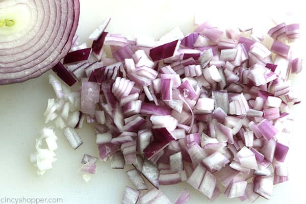 Diced red onion on cutting board.