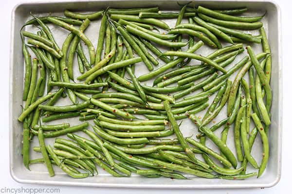 Fresh green beans on a sheet pan.