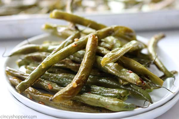 Roasted green beans on a plate.