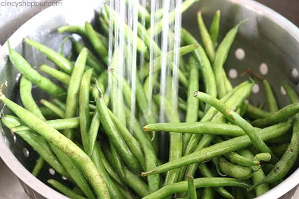 Rinsing fresh green beans.