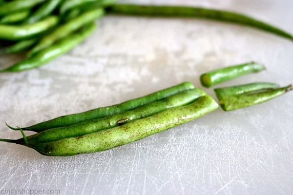 Trimming fresh green beans.