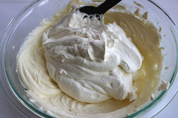 Adding whipped topping to cream cheese for lime cheesecake