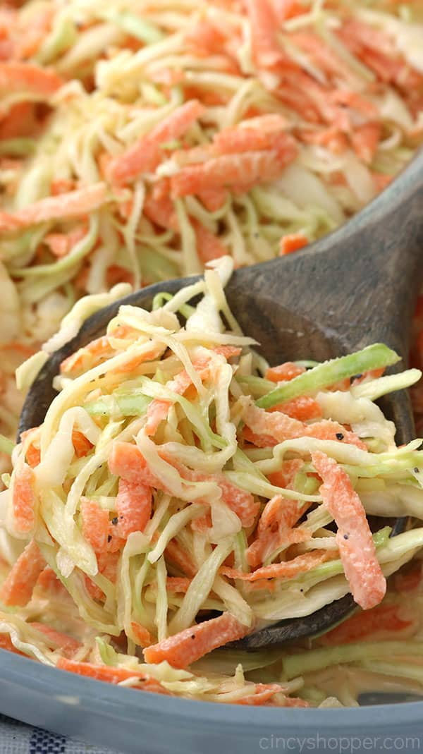 Homemade coleslaw on spoon.