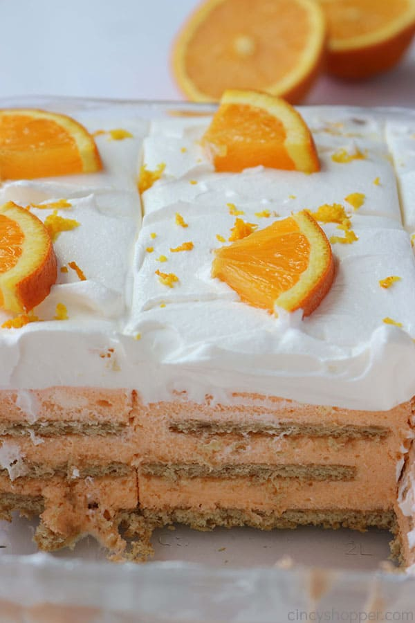 Slices of Orange Creamsicle Icebox Cake in a dish.