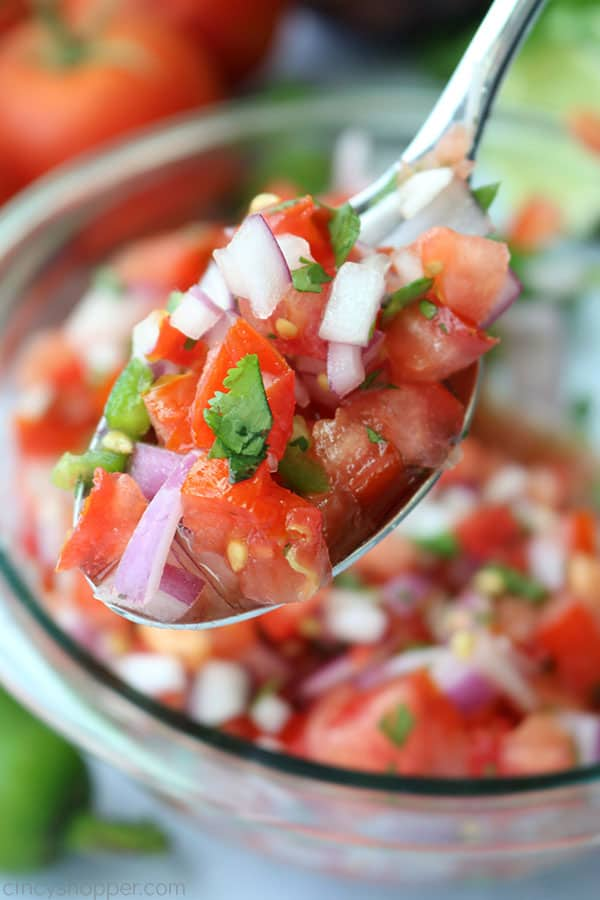 Fresh Pico de Gallo salsa on a spoon