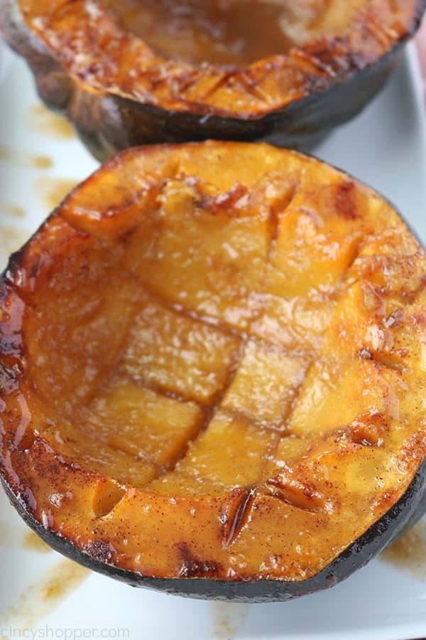 Baked Acorn Squash on a white platter.