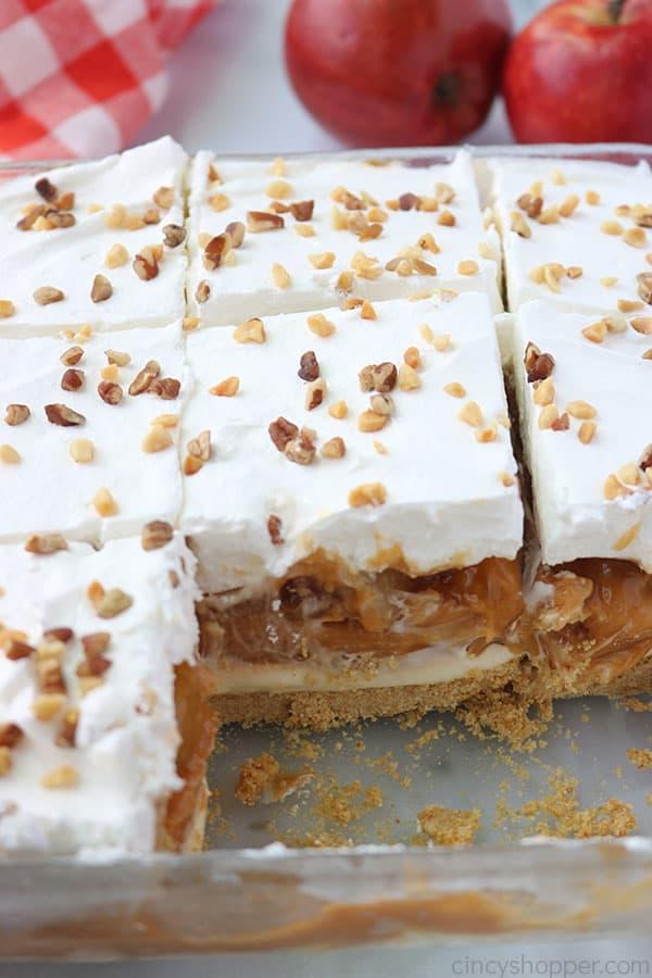 Layered Caramel Apple dessert bars in a baking dish.