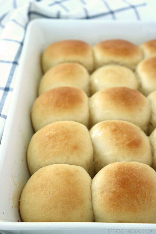 Homemade dinner rolls in a white baking dish.