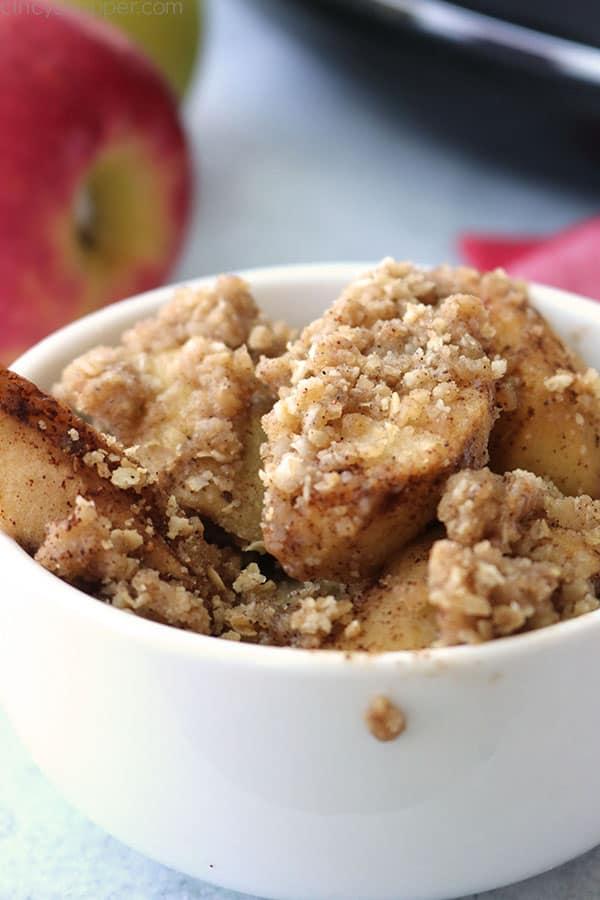 Slow Cooker Apple Crisp in a white bowl