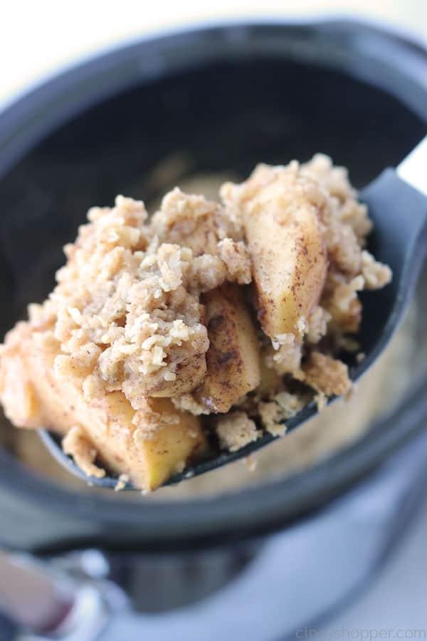 Slow Cooker Apple Crisp on a spoon.