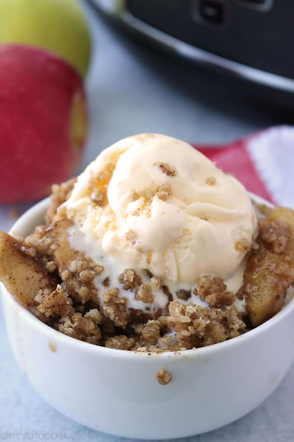 Slow Cooker Apple Crisp in a bowl with vanilla ice cream.