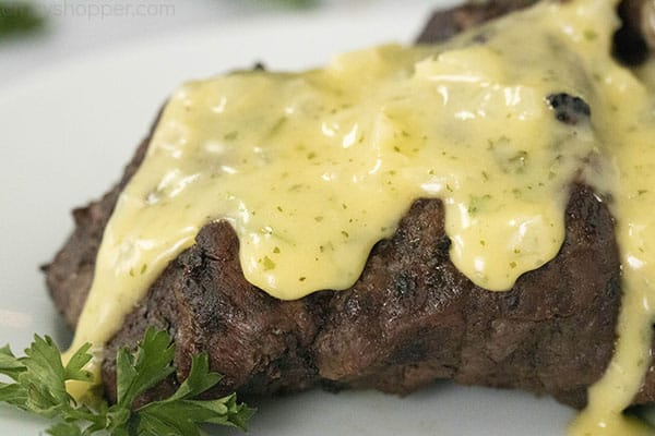 close up of a steak with bearnaise sauce on top