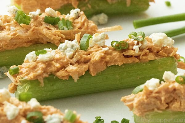 slices of celery stuffed with Buffalo chicken