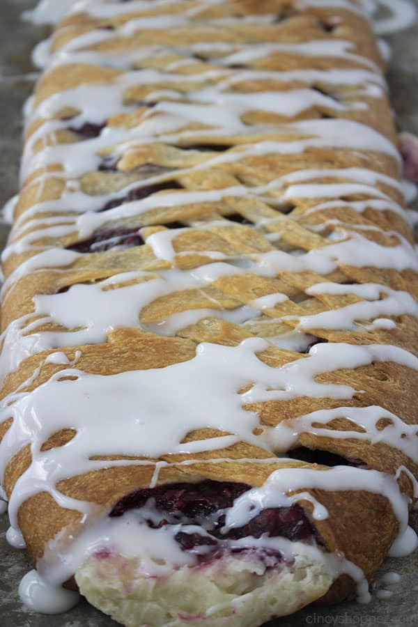 glazed homemade pastry braid with raspberry filling