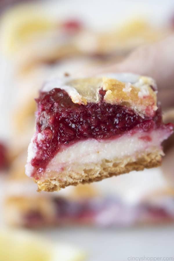 bite of raspberry cream cheese danish pastry