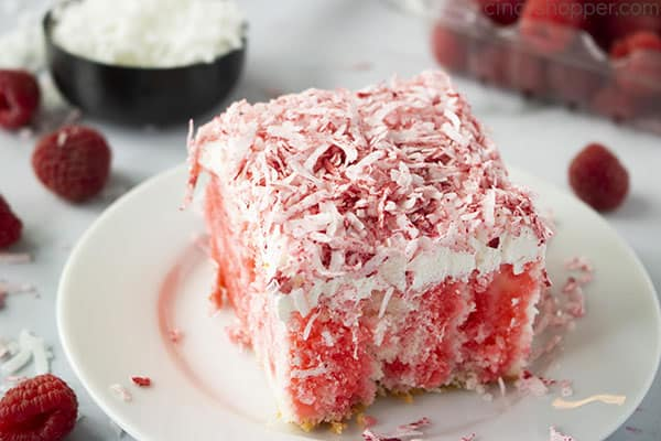 Fresh Raspberry Zinger Poke Cake with coconut