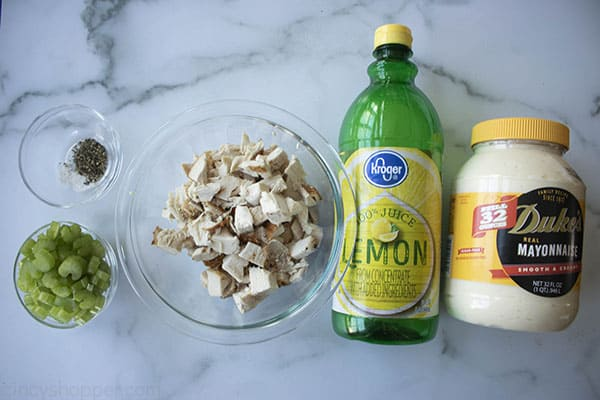 ingredients to make the best chicken salad recipe on marble board