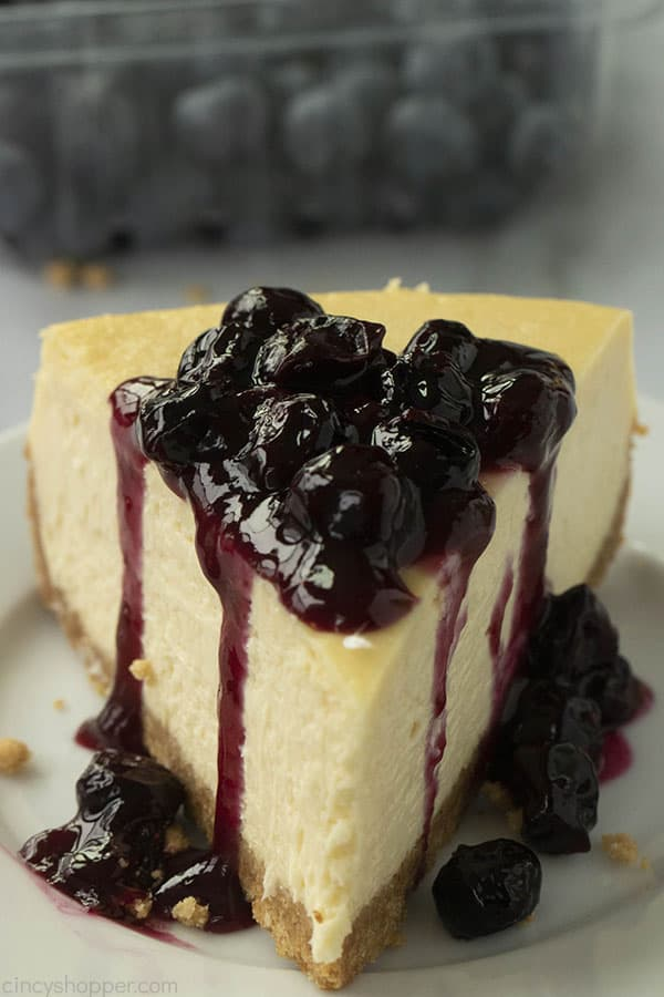 new york style cheesecake topped with blueberry sauce