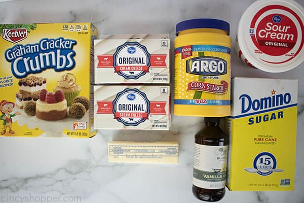 ingredients to make cheesecake recipe laid out on a counter