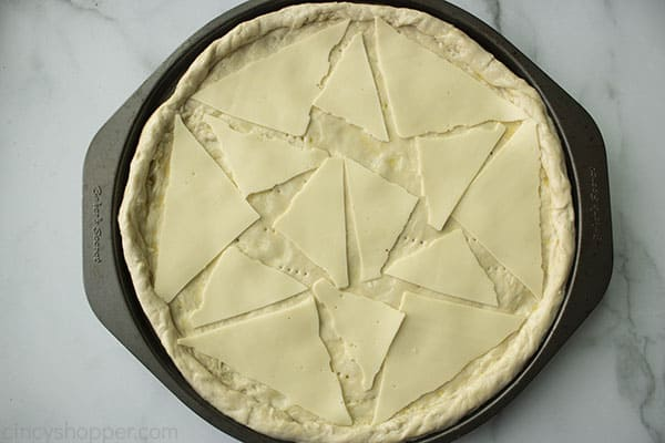 triangles of white American cheese slices on top of pizza crust