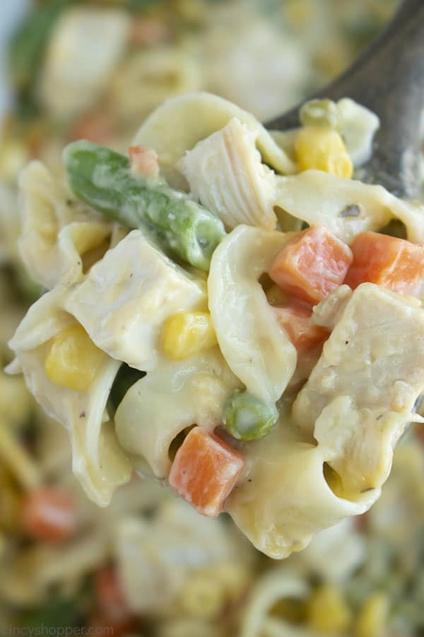 close up of chicken casserole with noodles on a fork