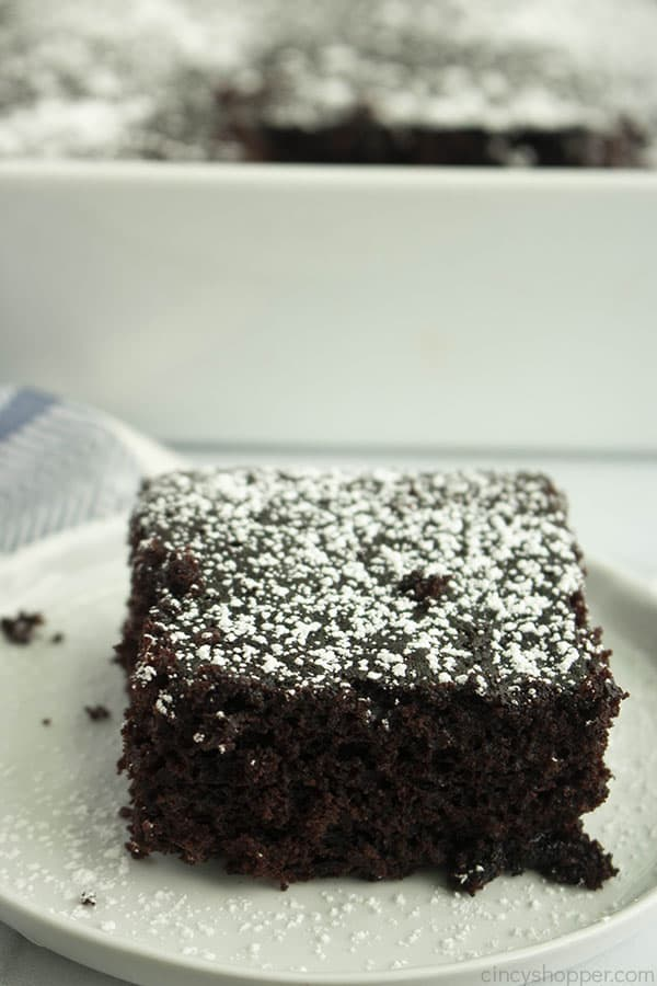 square slice of chocolate depression cake with powdered sugar on top