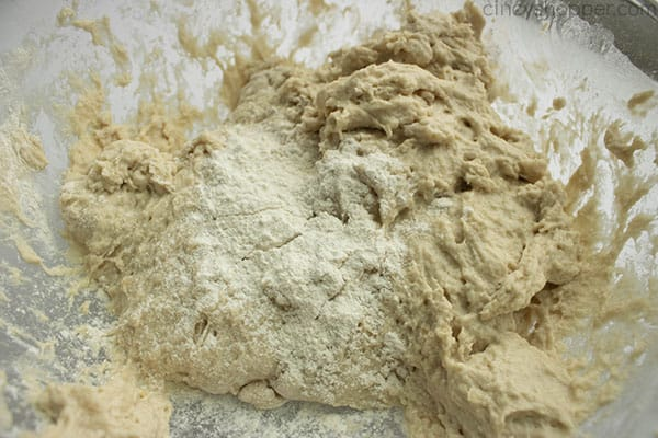 making a bread recipe - incorporating flour into shaggy dough