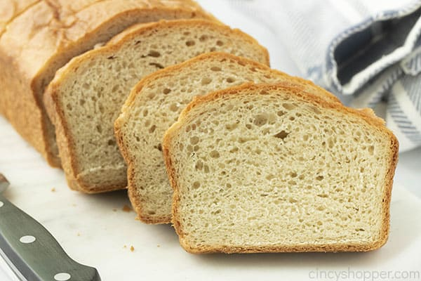 sliced loaf of white homemade bread