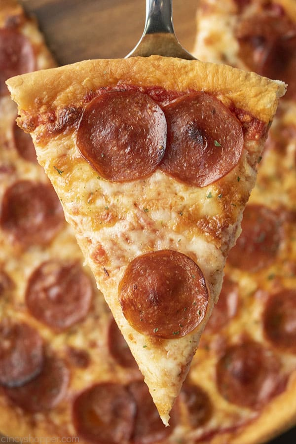 Slice of pepperoni pizza using Homemade Pizza Dough recipe