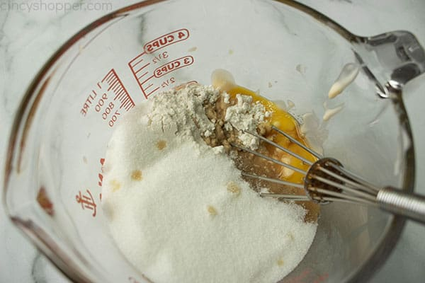 Brown sugar, flour, peach yogurt and vanilla with egg yolks and whisk