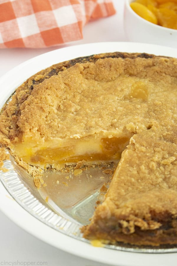 Fresh baked pie with peaches and custard in a pie tin
