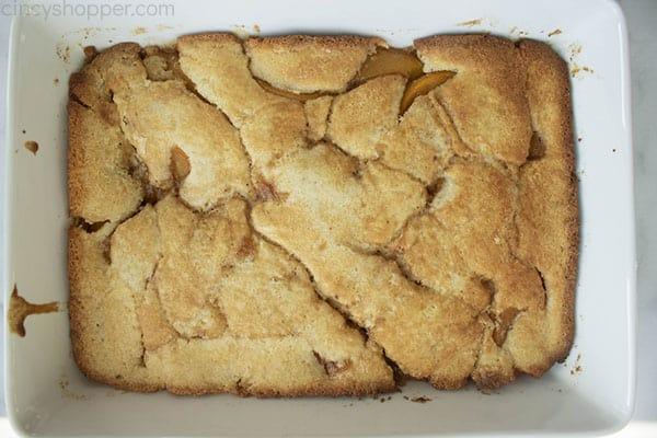 Baked Peach Cobbler in white baking dish